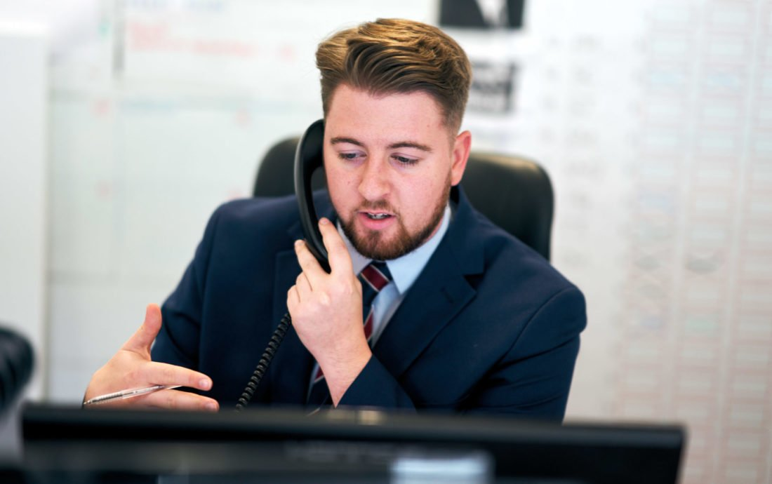 Alex on the phone during working hours at Oyster Partnership recruitment agency talking to a planning officer